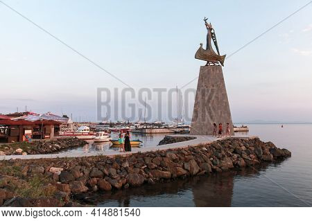 Nessebar, Bulgaria - July 20, 2014: Tourists Walk Near The Statue Of Saint Nicholas In Nessebar Old