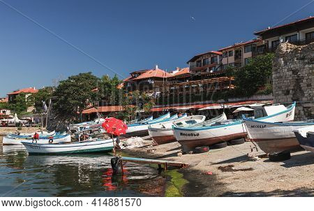 Nessebar, Bulgaria - July 21, 2014: Wooden Fishing Boats Lay On The Slope In Old Town Nesebar, Black