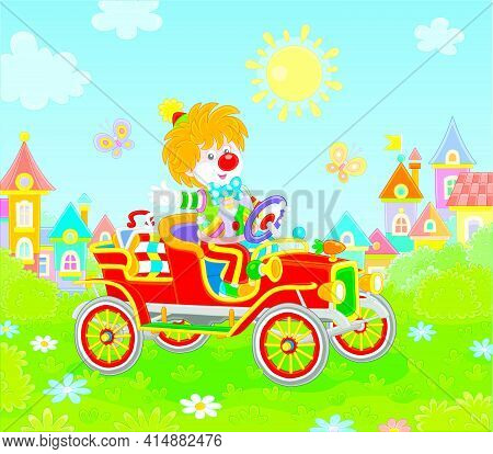 Friendly Smiling Clown In A Colorful Comic Suit Driving A Funny Retro Car In A Circus Performance On