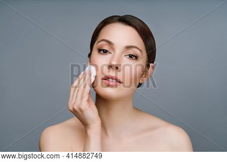 A Natural Woman With Good Skin Cleanses Her Face With A Cotton Pad. Spa, Cosmetology, Beauty