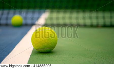 Close Up Of Tennis Equipment On The Court. Sport, Recreation Concept. Yellow Tennis Balls In Motion