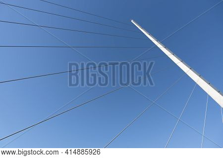 Mast And Cables Of The Puente De La Mujer, A Modern Rotating Footbridge Located In Puerto Madero, Bu