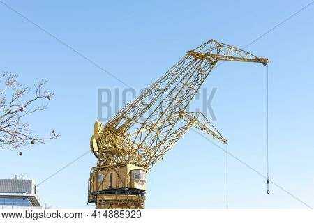 Buenos Aires, Argentina; Oct 31, 2019: Yellow Inactive Historical Cranes, In Puerto Madero. Image Wi