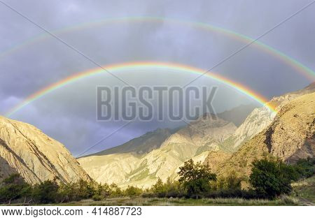 Double Rainbow And Heavy Rain Over The Mountain Valley. Two Full Bright Rainbows During The Autumn R