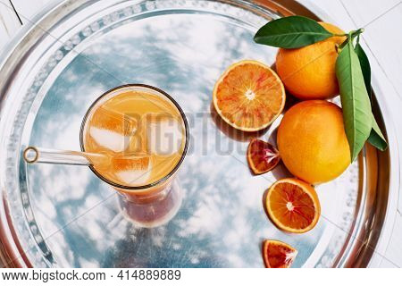 Summer Orange Cocktail. Fresh Healthy Citrus Juice With Ice On Steel Tray Top View. Ripe Bio Citrus
