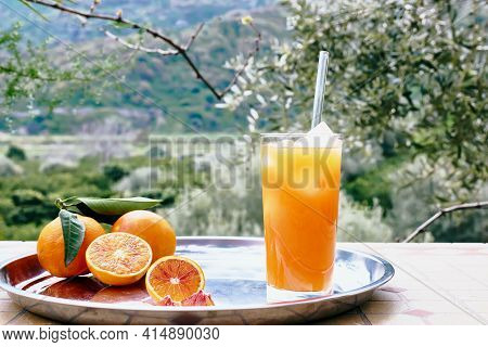 Summer Orange Cocktail. Fresh Healthy Citrus Juice With Ice And Ripe Bio Citrus Fuits On Steel Tray