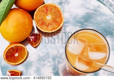 Summer Orange Cocktail. Fresh Healthy Citrus Juce With Ice On Steel Tray Top View. Ripe Bio Citrus F