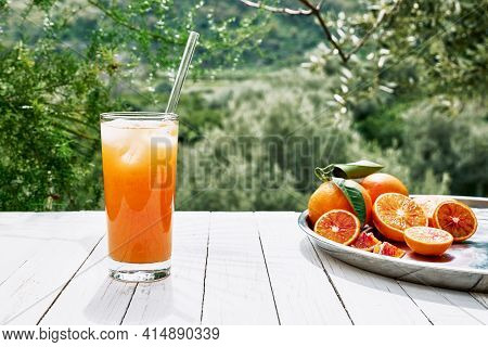 Summer Orange Cocktail. Fresh Healthy Citrus Juce With Ice And Ripe Bio Citrus Fuits On Steel Tray O