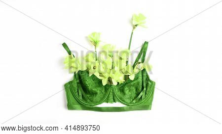 Women's Lace Bra Of Green Color And Fresh Spring Flowers On A White Background, Top View, Flat Lay.
