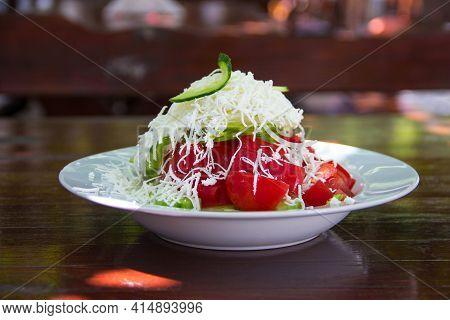 Traditional Bulgarian Salad - Shopska Salad Served On Table
