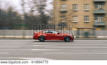 Moscow, Russia - March 2021: Red Aggressive Bmw Sport Car Riding On The Road. Side View Of Shiny Bmw