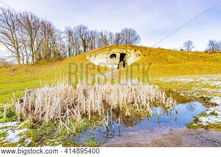 Dutch Valley With A Pond And The Limestone Cave Duivelsgrot (devil's Cave) Or Wijngaardgroeve (viney