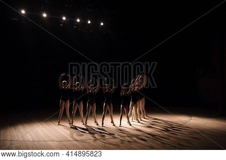 Young Ballerinas Practicing A Choreographed Dance All Raining Their Arms In Graceful Unison During P