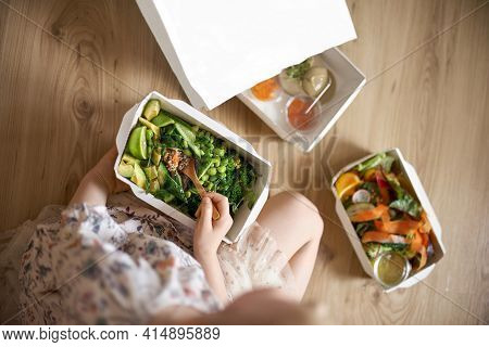Food Delivery Concept. The Girl Takes Out Salads From The Package. Healthy Food. Top View, Copy Spac