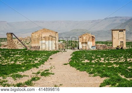 Zaida, Morocco - April 09, 2015. Ruins Of Old Buildings In Desert Inhabited By Berber Family