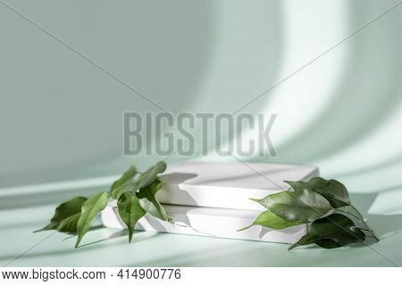 Abstract Empty White Podium On Pastel Background With Shadow. Mock Up Stand For Product Presentation