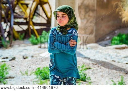Aouli, Morocco - April 10, 2015. Too Young Girl Wearing Scarf As A Traditional Part Of Adult Woman