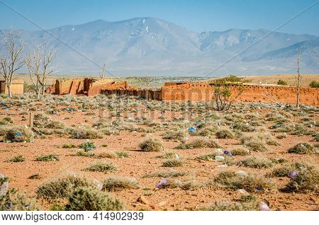 Aouli, Morocco - April 10, 2015. Huge Amount Of Rubbish Dispersed In Desert Between Abandoned Ruins