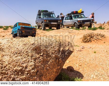 Zaida, Morocco - April 10, 2015. Toy Car In Terrain As A Comparison Of Real Cars Of Range Rover Clas