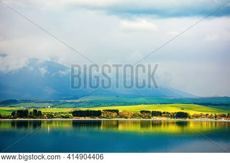 Liptovska Mara Lake Of Slovakia. Beautiful Landscape In Spring. Reflection On The Water Surface. Dis