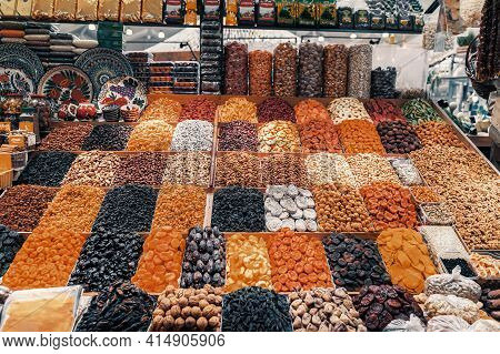 Set Of Nuts And Dried Fruits On Counter At Wholesale Market. Healthy Nutrition, Vegan Sweets. Natura