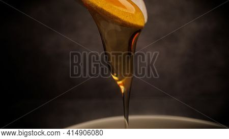 Macro Shot Of Flowing Honey - Studio Photography