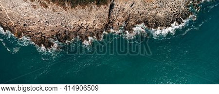 Aerial View Of Rocky Beach And Sea With Clear Blue Water At Sunset. Coast Of The Adriatic Sea At Sun