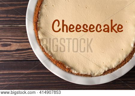 Cheesecake In A Baking Dish. Classic Cheesecake In New York Style On Wooden Background.
