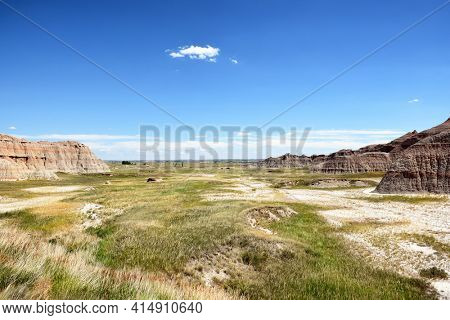 Badlands National Park. The park's 244,000 acres protect an expanse of mixed-grass prairie that support bison, bighorn sheep, prairie dogs, and black-footed ferrets.