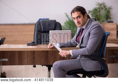 Young businessman employee in bullying concept in the office