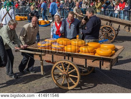 Alkmaar, Netherlands - April 28, 2017: Cheese buyers at traditional cheese market.