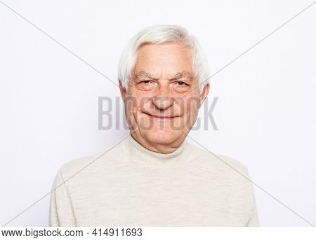 Old people, emotion and modern lifestyle concept. Senior smiling man with gray hair wearing casual over white background.