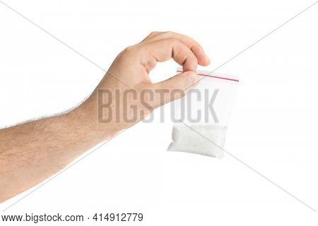 Hand and packet with narcotic isolated on white background