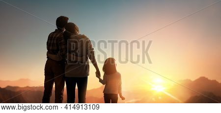 Happy family at sunset. Father, mother and child are having fun and enjoying journey.