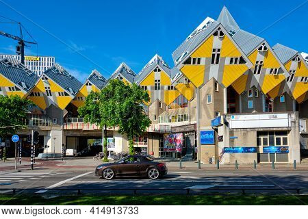 ROTTERDAM, NETHERLANDS - MAY 11, 2017: Cube houses - innovative cube-shaped houses designed by architect Piet Blom with idea to optimize space in Rotterdam, Netherlands now became a tourist attraction