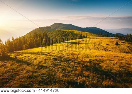 Morning sunlight illuminates the mountain ranges. Location place Carpathian mountains, Ukraine, Europe. Vibrant photo wallpaper. Summer holiday destinations. Explore the beauty of earth.