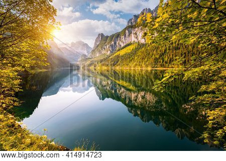 Splendid scene of alpine lake Vorderer Gosausee. Location place of famous resort Salzkammergut, Gosau Valley, Upper Austria, Europe. Dachstein glacier. Photo wallpaper. Discover the beauty of earth.