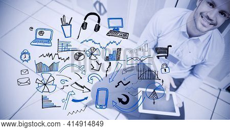 Composition of digital icons over businessman using tablet in office. global business and finance, connection and networking concept digitally generated image.
