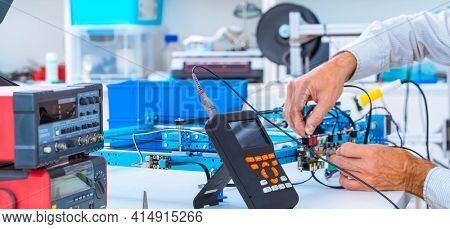 assembly of electronic devices in electronics lab