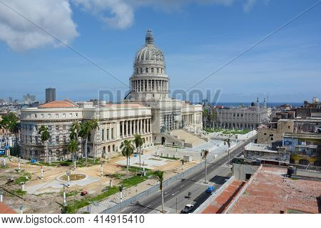 HAVANA, CUBA - JULY 23, 2016: Capitol Building with scaffolding. The Capitol is undergoing restoration. Also shown is the Gran Teatro.