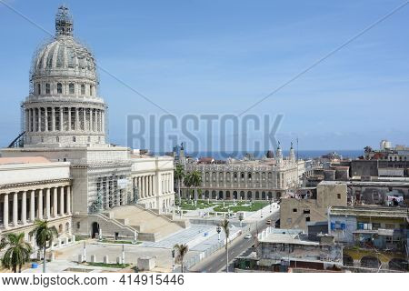 HAVANA, CUBA - JULY 23, 2016: Capitol Building with scaffolding. The Capitol is undergoing restoration. Also shown is the Gran Teatro