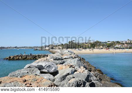 NEWPORT BEACH, CA - MARCH 28, 2017: Corona Del Mar State Beach and Newport Channel seen from the jetty rocks.