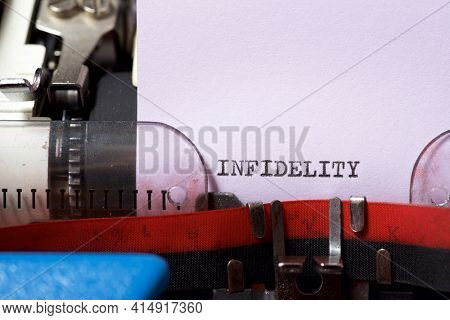 Infidelity word written with a typewriter.
