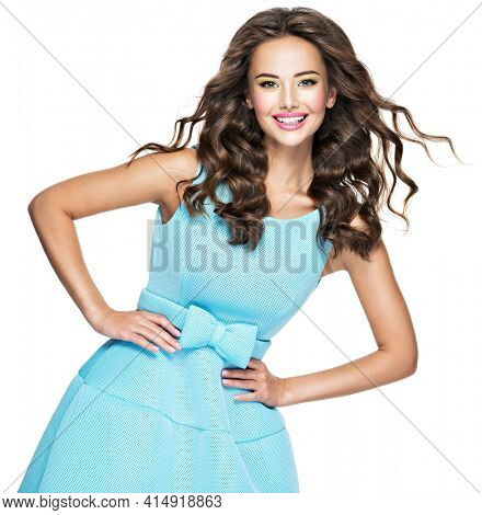 Beautifulhappy woman in blue dress long  hair brown. Happy Fashionable Woman with expressive emotions.