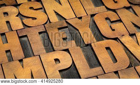 background of random vintage letterpress wood type printing blocks