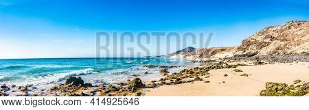 Panorama of a sandy beach with stones in the Canary Islands