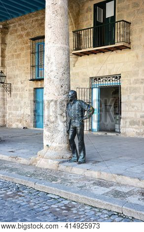HAVANA, CUBA - JULY 24, 2016: Bronze Sculpture leaning on Column in Old Town. The area is known for its many public sculptures.