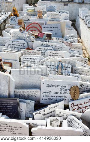HAVANA, CUBA - JULY 21, 2016: Plaques next to the tomb of Amelia Goyri de la Hoz, La Milagrosa (The Miraculous One). The tomb is a symbol of motherhood, love to children.