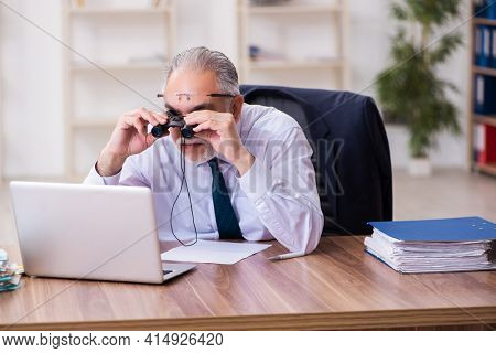Old businessman employee in budget planning concept