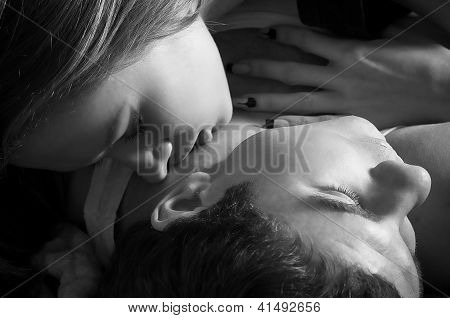 Portrait of loving sensuality couple in dark